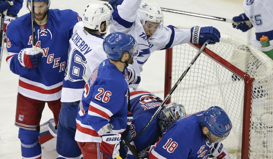 Tampa Bay Lightning center Tyler Johnson (9) reacts as he scores his third goal of the game against the New York Rangers during the second period of Game 2 of the Eastern Conference final during the NHL hockey Stanley Cup playoffs, Monday, May 18, 2015, in New York. (AP Photo/Frank Franklin II)