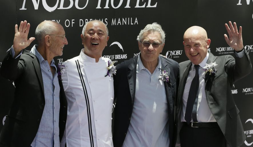 From right, Trevor Horwell, CEO of Nobu Hospitality, Hollywood actor Robert De Niro, Japanese culinary Chef Nobu Matsuhisa and Hollywood film producer Meir Teper pose during the ribbon-cutting ceremony at the opening of the Nobu Hotel at the City of Dreams Casino Monday, May 18, 2015 at suburban Pasay city, south of Manila, Philippines.  Robert de Niro and his business partners have formally opened Asia's first Nobu Hotel in Manila as the luxury brand gears up for global expansion.(AP Photo/Bullit Marquez)