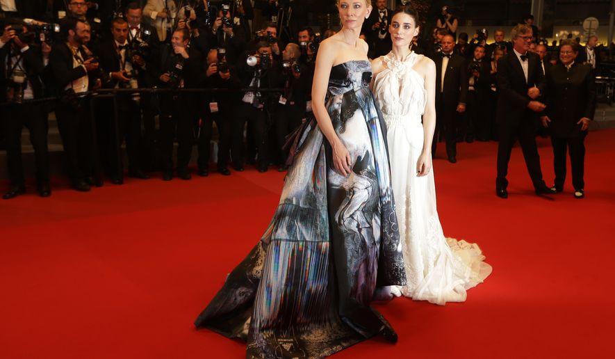 Cate Blanchett and Rooney Mara depart following the screening of the film Carol at the 68th international film festival, Cannes, southern France, Sunday, May 17, 2015. (Photo by Joel Ryan/Invision/AP)