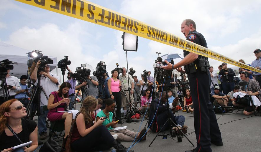Waco Police Sgt. Patrick Swanton addresses the media as law enforcement continues to investigate the motorcycle gang related shooting at the Twin Peaks restaurant, Monday, May 18, 2015, in Waco, Texas, where nine were killed Sunday and over a dozen injured. About 170 gang members charged with engaging in organized crime are each being held on a $1 million bond and authorities say charges of capital murder are expected in the wake of the Central Texas shooting. (AP Photo, Jerry Larson)