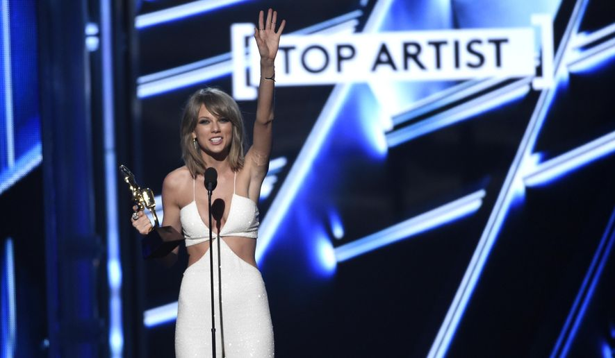 Taylor Swift accepts the award for top artist at the Billboard Music Awards at the MGM Grand Garden Arena on Sunday, May 17, 2015, in Las Vegas. (Photo by Chris Pizzello/Invision/AP)