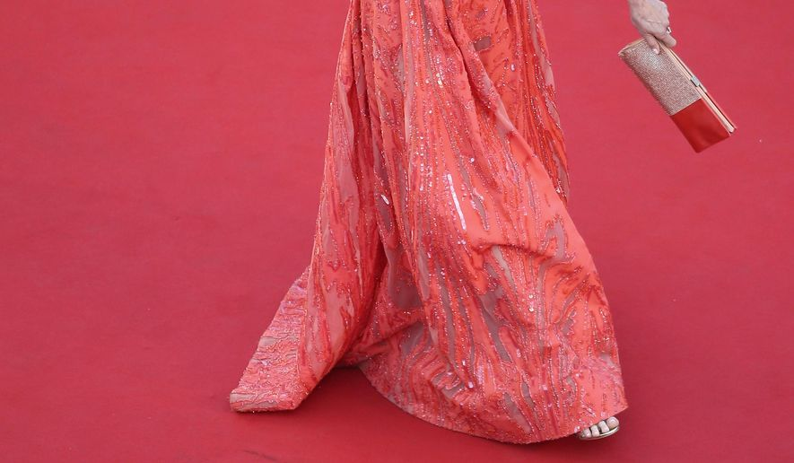 Actress Andie MacDowell poses for photographers as she arrives for the screening of the film Inside Out at the 68th international film festival, Cannes, southern France, Monday, May 18, 2015. (AP Photo/Laurent Rebours, Pool)