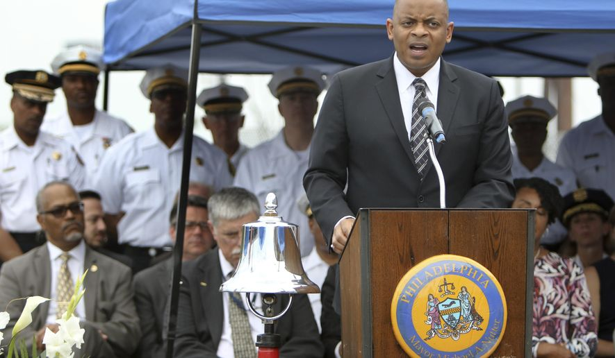 """Anthony Foxx, U.S. Secretary of Transportation, speaks during a service of reflection at the site of an Amtrak train derailment, Sunday May 17, 2015, in Philadelphia. The U.S. passenger train operator Amtrak will resume full service in the Northeast Corridor on Monday in """"complete compliance"""" with federal safety orders following last week's deadly derailment, officials announced Sunday. (AP Photo/ Joseph Kaczmarek)"""