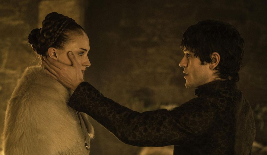 "This photo provided by courtesy of HBO shows, Sophie Turner, left, as Sansa Stark, and Iwan Rheon, as Ramsay Bolton, in a scene from season 5 of ""Game of Thrones."" The show airs Sundays at 9 p.m. EDT. (Helen Sloan/HBO via AP)"