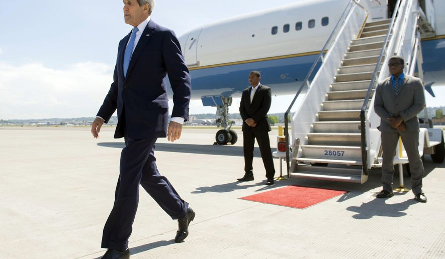 US Secretary of State John Kerry disembarks from his airplane upon arrival at Boeing Field in Seattle, Washington, Monday, May 18, 2015. Kerry returned to the US following a 3-day trip to China and South Korea. (Saul Loeb/Pool Photo via AP)