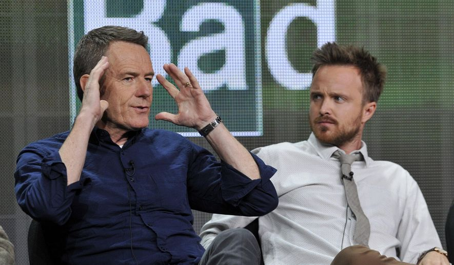 "FILE - In this July 26, 2013 file photo, Bryan Cranston, left, and Aaron Paul, cast members in ""Breaking Bad,"" take part in a panel discussion during AMC's Summer 2013 TCA press tour in Beverly Hills, Calif. A University of New Mexico School of Law student journal has published a special issue analyzing legal issues related to the story line of AMC-TV's ""Breaking Bad."" An edition of the New Mexico Law Review released this week looks at the war on drugs, the hypothetical arrest of Walter White, and questionable practices of defense lawyer Saul Goodman.Editor Matthew Zidovsky says students wanted to use the fictional hit television series to discuss serious legal issues like the Fourth Amendment and professional lawyer ethics. (Photo by Chris Pizzello/Invision/AP, File)"