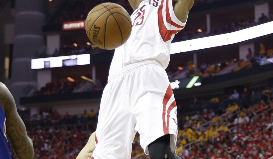 Houston Rockets' Corey Brewer (33) scores over Los Angeles Clippers' Austin Rivers (25) during the second half in Game 5 of the NBA basketball Western Conference semifinals Tuesday, May 12, 2015, in Houston. (AP Photo/David J. Phillip)