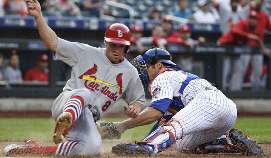 St. Louis Cardinals' Peter Bourjos (8) slides past New York Mets catcher Anthony Recker to score on a Randal Grichuk double during the first inning of a baseball game Tuesday, May 19, 2015, in New York. (AP Photo/Frank Franklin II)