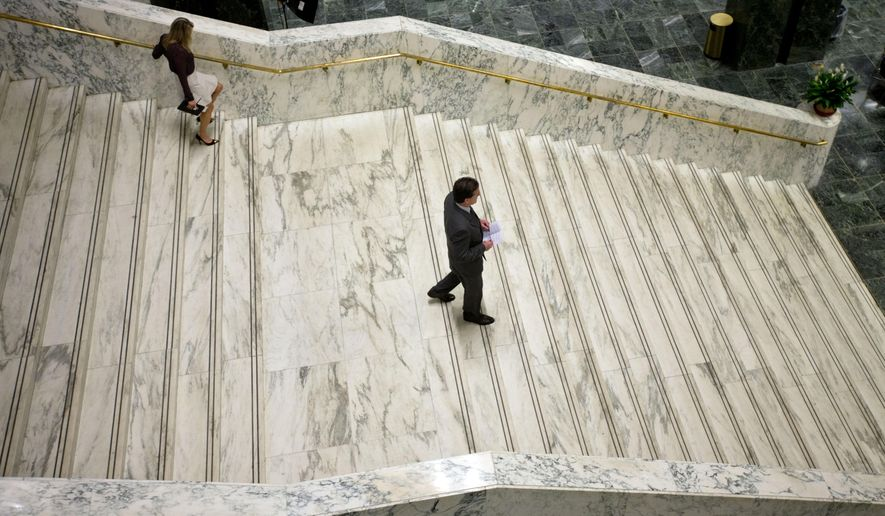 Senate Majority Leader John Flanagan, R-Smithtown, walks down a staircase at the Legislative Office Building after speaking at a property tax-cap news conference on Tuesday, May 19, 2015, in Albany, N.Y. (AP Photo/Mike Groll)