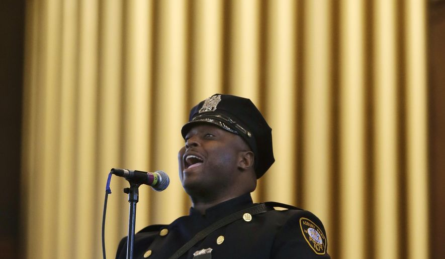 """Asbury Park police officer Tyron McAllister sings, """"You Raise Me Up,"""" during the state's Police Chiefs Foundation's 31st annual memorial service in Ocean Grove's Great Auditorium Tuesday, May 19, 2015, in the Ocean Grove section of Neptune, N.J. Police officers from around New Jersey attended the service to remember officers who died in the line of duty. (AP Photo/Mel Evans)"""