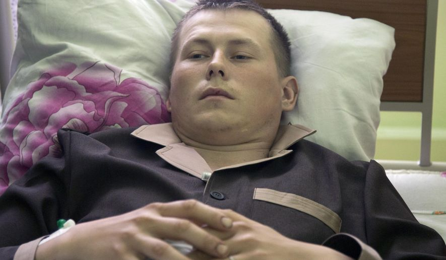 Alexander Alexandrov, who says he is a sergeant with the Russian special forces from the Volga River city of Togliatti, lies in a military hospital bed, in Kiev, Ukraine, Tuesday, May, 19, 2015. Two wounded Russian soldiers captured while fighting in war-torn eastern Ukraine have been transferred to a hospital in Kiev, Ukrainian officials said Monday as Moscow once again firmly denied any involvement in the fighting. (AP Photo/Efrem Lukatsky)