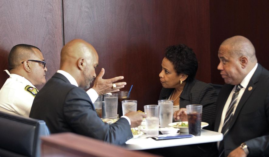 From left: Cincinnati Chief of Police Jeffrey Blackwell, U.S.Attorney for the Southern District of Ohio Carter M. Stewart, U.S. Attorney General Loretta Lynch and Director of Community Oriented Policing Services Ron Davis, eat lunch in downtown Cincinnati, Tuesday, May 19, 2015.  Lynch began a national tour highlighting collaborative programs and policing practices designed to improve public safety and strengthen police-community relations.  The Justice Department says the tour is intended to promote $163 million in grants available to build on President Barack Obama's commitment to work with law enforcement and others to implement recommendations from the 21st Century Policing Task Force report. (Kareem Elgazzar/The Cincinnati Enquirer via AP)  MANDATORY CREDIT;  NO SALES