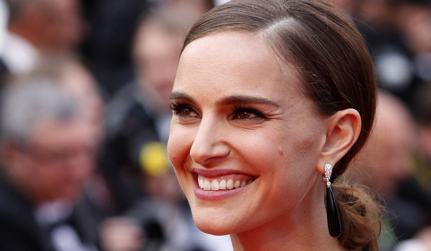 Actress Natalie Portman poses for photographers as she arrives for the screening of the film Sicario at the 68th international film festival, Cannes, southern France, Tuesday, May 19, 2015. (AP Photo/Lionel Cironneau)