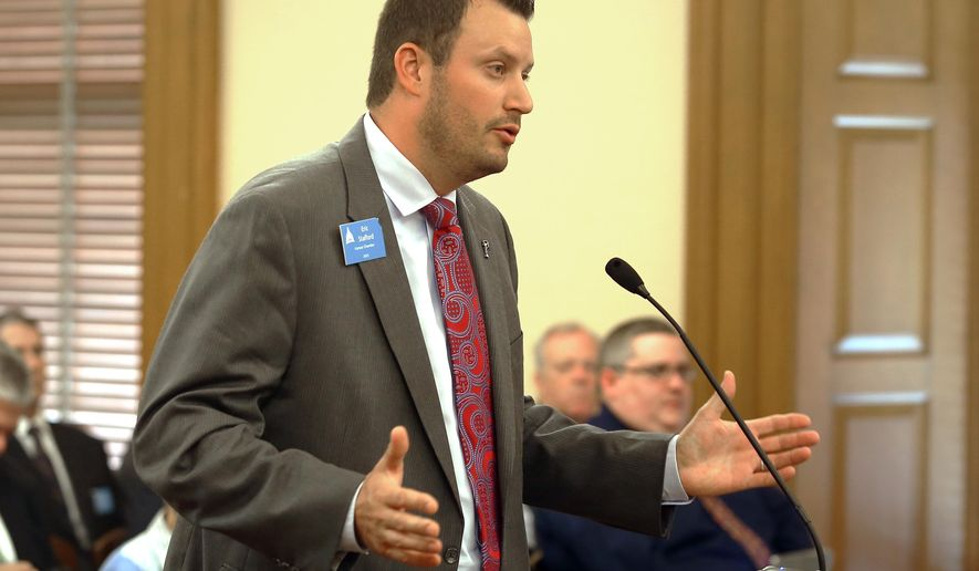 Eric Stafford, with the Kansas Chamber of Commerce, testifies Tuesday, May, 19,2015, in Topeka, Kan., before the House Tax Committee in opposition to a bill that would roll back tax exemptions on business income but maintain tax-free status for income up to $150,000. (Thad Allton/The Topeka Capital-Journal via AP)