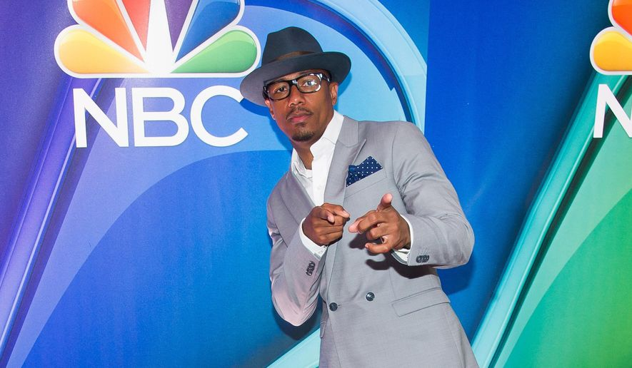 FILE - In this May 11, 2015 file photo, Nick Cannon arrives at the NBC Network 2015 Programming Upfront presentation at Radio City Music Hall in New York. Cannon will attempt to dance nonstop for 24 hours as a warm up to Thursday, May 21, 2015 broadcast of Red Nose Day.   (Photo by Charles Sykes/Invision/AP, File)