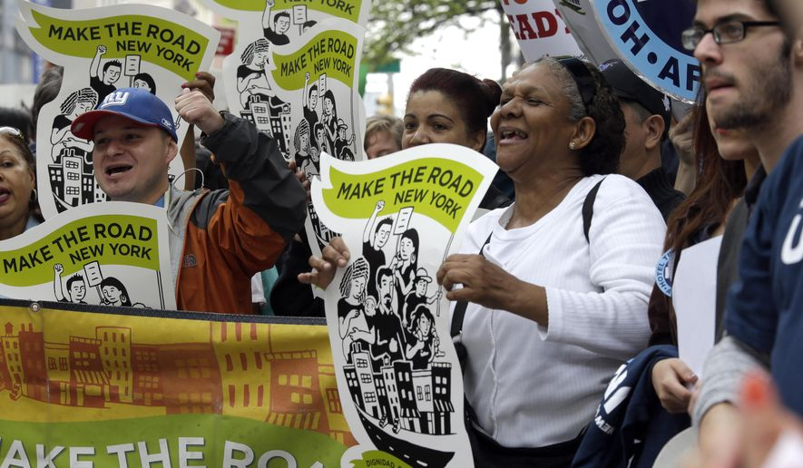 Edita Nolasco, second from right, who is originally from the Dominican Republic and currently lives in Brooklyn, chants slogans with other demonstrators during a National Day of Action to #Fight4DAPA rally, Tuesday, May 19, 2015, in New York. The demonstrators are demanding the end of a lawsuit that blocks a program to protect from deportation, parents of U.S. citizens or permanent residents. (AP Photo/Mary Altaffer)