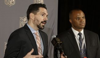 Dean Blandino, left, NFL vice president of officiating, speaks next to Rick Smith, Houston Texans general manager, at the NFL's spring meetings in San Francisco, Tuesday, May 19, 2015. (AP Photo/Jeff Chiu)