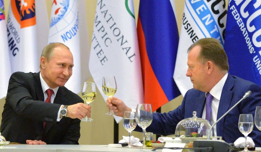 FILE - In this Monday, April 20, 2015 file photo, Russian President Vladimir Putin, left, toasts with Marius Vizer, head of IFJ and SportAccord Convention president, during a reception in Sochi, Russia. A month after launching a scathing attack on the IOC, the head of SportAccord, Marius Vizer, says Tuesday May 19, 2015, he has proposed a meeting with Thomas Bach to repair the damage that has led multiple sports to cut ties with the umbrella body for international federations. (Alexei Druzhinin/RIA Novosti, Kremlin Pool Photo via AP, File)