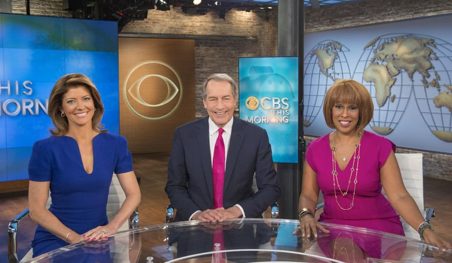 "In this June 19, 2014 photo released by CBS, co-hosts Norah O'Donnell , from left, Charlie Rose and Gayle King appear on the set of ""CBS This Morning,"" in New York. On Wednesday, May 19, 2015, ""CBS This Morning,"" will broadcast its entire two-hour show from the new 102nd floor observation deck at One World Trade Center. (John Paul Filo/CBS via AP)"