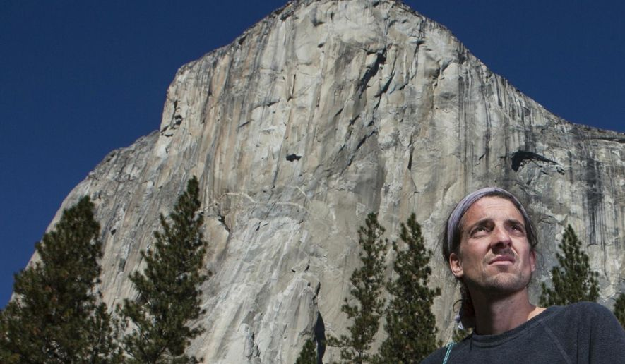In this Monday, Nov. 15, 2010 photo provided by Tomas Ovalle, extreme athlete Dean Potter stands in front of El Capitan after a speed climbing attempt up El Capitan in Yosemite National Park, Calif. Potter, renowned for his daring and sometimes rogue climbs and BASE jumps, and his climbing partner Graham Hunt were killed Saturday, May 16, 2015 after jumping from a 7,500-foot promontory called Taft Point in Yosemite National Park.  (AP Photo/Tomas Ovalle)