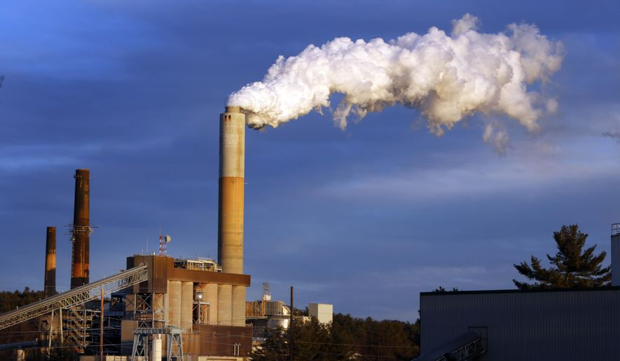 FILE - In this Tuesday Jan. 20, 2015 file photo, a plume of steam billows from the coal-fired Merrimack Station in Bow, N.H. Colorado Gov. John Hickenlooper, whose state relies heavily on coal for energy, is openly rejecting Senate Majority Leader Mitch McConnell's call for states to defy new federal pollution controls on coal-burning power plants. (AP Photo/Jim Cole, File)