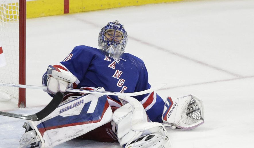 New York Rangers goalie Henrik Lundqvist rolls onto his back after giving up a goal to the Tampa Bay Lightning during the third period of Game 2 of the Eastern Conference final during the NHL hockey Stanley Cup playoffs, Monday, May 18, 2015, in New York. (AP Photo/Frank Franklin II)