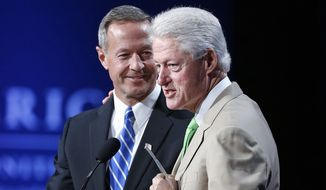 FILE - In this June 25, 2014 file photo, former President Bill Clinton speaks alongside then-Maryland Gov. Martin O'Malley during the closing session on the final day of the annual gathering of the Clinton Global Initiative America, in Denver. More than a decade ago, Bill Clinton spotted a political star on the horizon, someone he predicted would go from a big-city mayor to a national leader _ maybe even to the White House. In the years that followed, Clinton and his wife, New York Senator Hillary Rodham Clinton, showed up time and again as their young ally rose up the political ranks, hosting fundraisers, headlining rallies, and connecting him with their sprawling network of political donors.  (AP Photo/Brennan Linsley, File)