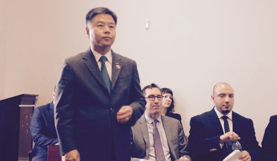 Rep. Ted W. Lieu, California Democrat, prepares to discuss his new bill, the Therapeutic Fraud Prevention Act, which would ban for-profit therapy that purports to help people turn from gay to straight. David Dinielli, deputy legal director of the Southern Poverty Law Center (center), and Ryan Kendall, a survivor of conversion therapy (right), also addressed the May 19, 2015, press conference held in the Cannon House Office Building on Capitol Hill. (Cheryl Wetzstein/The Washington Times) **FILE**