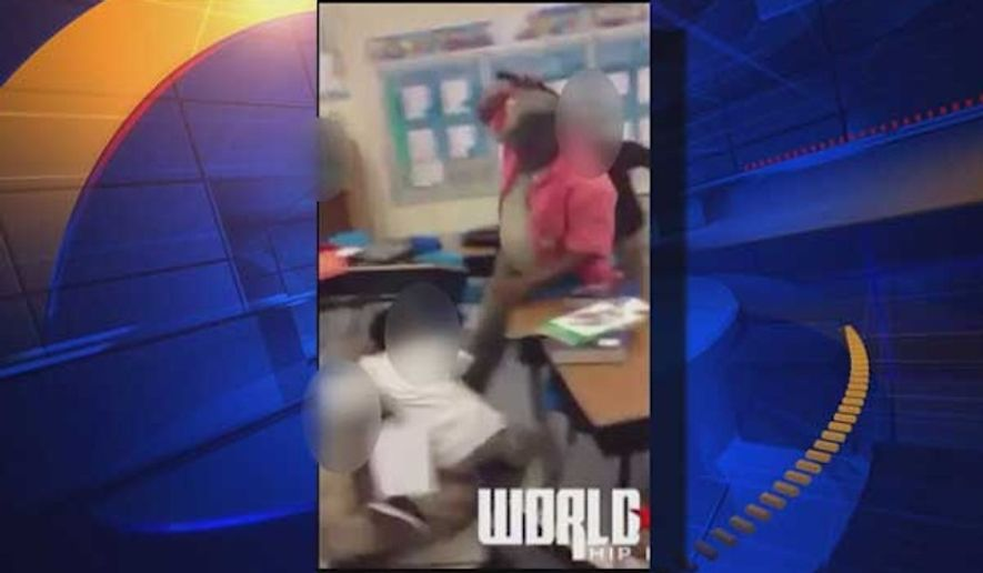 A substitute teacher at Gwynn Park Middle School in Prince George's County, Maryland, has been removed from the classroom after a video surfaced showing him striking a group of screaming middle school children with a belt. (WTTG-TV)
