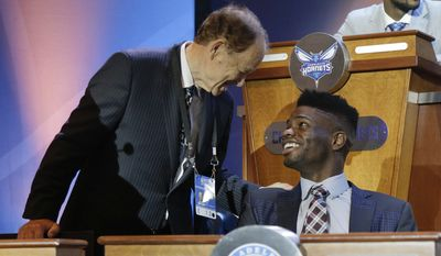 Minnesota Timberwolves owner Glen Taylor, left, talks with Philadelphia 76ers' Noel Nerlens before the NBA basketball draft lottery Tuesday, May 19, 2015, in New York. (AP Photo/Julie Jacobson)