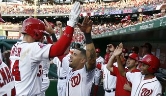 Washington Nationals' Bryce Harper, left, celebrates his solo home run with Ian Desmond, who also hit a solo home run during the first inning of an interleague baseball game against the New York Yankees at Nationals Park, Tuesday, May 19, 2015, in Washington. (AP Photo/Alex Brandon)