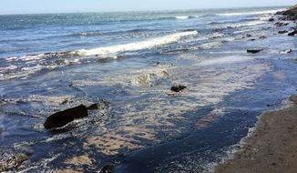 An oil slick from a broken pipeline is seen near Santa Barbara on Tuesday. (Associated Press)