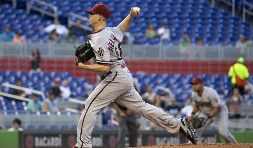 Arizona Diamondbacks starting pitcher Jeremy Hellickson throws to  Miami Marlins batter during the first inning of a baseball game in Miami, Tuesday, May 19, 2015. (AP Photo/J Pat Carter)
