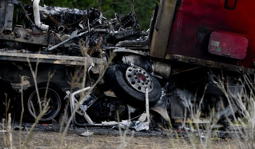 A tractor trailer sits on top of a crushed car after a multiple car accident on I-16 in Pooler, Ga. on Tuesday, May 19, 2015. (Ian Maule/Savannah Morning News via AP) MANDATORY CREDIT THE EXAMINER.COM; SFEXAMINER.COM AND WASHINGTONEXAMINER.COM