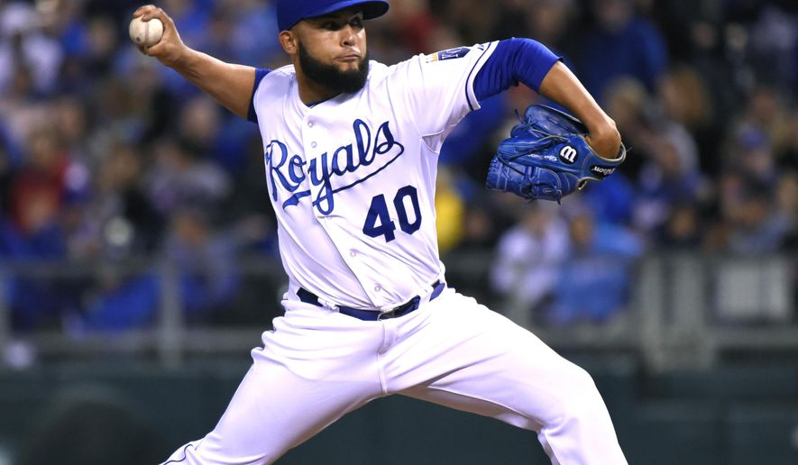 Kansas City Royals' Kelvin Herrera throws in the eighth inning against the Cincinnati Reds during a baseball game Tuesday, May 19, 2015, in Kansas City, Mo.  (AP Photo/Ed Zurga)