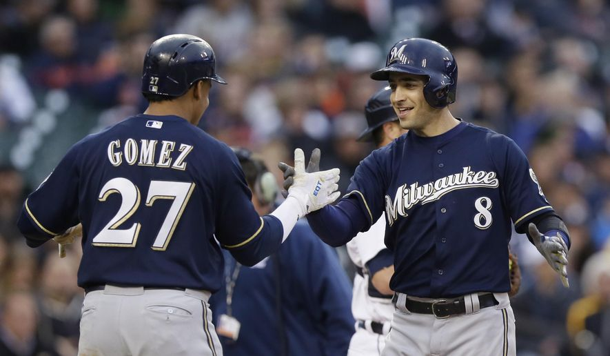 Milwaukee Brewers' Ryan Braun (8) is congratulated by Carlos Gomez after they both scored on Braun's three-run home run off Detroit Tigers starting pitcher Anibal Sanchez during the third inning of an interleague baseball game, Tuesday, May 19, 2015, in Detroit. (AP Photo/Carlos Osorio)