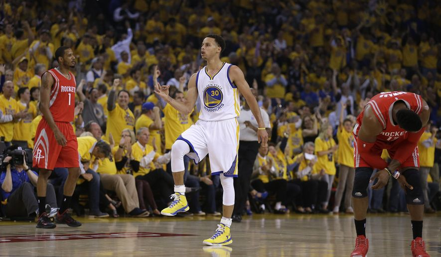 Golden State Warriors' Stephen Curry, center, celebrates between Houston Rockets' Dwight Howard, right, and Trevor Ariza after a score during the first quarter of Game 1 of the NBA basketball Western Conference finals Tuesday, May 19, 2015, in Oakland, Calif. (AP Photo/Ben Margot)