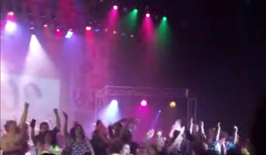 FILE - In this April 23, 2015 file image from video provided by Zach Rader,  students perform during a musical production at Westfield, Ind., High School just before a stage collapsed injuring 17 of the students. Authorities said Tuesday, May 19, 2015, an orchestra pit cover that collapsed during the performance, sending several students falling, had been replaced earlier this year and wasn't properly designed. Police say all but one of the injured students have returned to class and no charges will be filed. (Zach Rader via AP, File)
