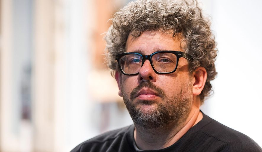 """FILE - In this May 1, 2015 photo, Neil LaBute poses on the set of his new play """"The Way We Get By"""" at the Second Stage Theatre in New York. A play festival benefiting the National Coalition Against Censorship will go on at a new location, but without the Neil LaBute play that led to the event being scrapped at its initial venue. Playwrights for a Cause said Tuesday that its festival featuring three new short plays about censorship in the arts will take place on June 14 at New York Theatre Workshop. (Photo by Charles Sykes/Invision/AP, File)"""