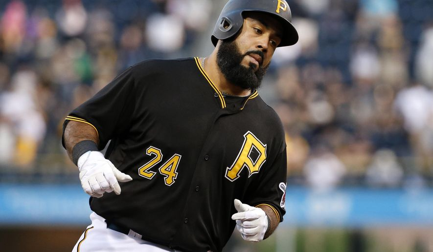 Pittsburgh Pirates' Pedro Alvarez rounds third after hitting a solo home run off Minnesota Twins starting pitcher Ricky Nolasco during the fourth inning of a baseball game in Pittsburgh on Tuesday, May 19, 2015. (AP Photo/Gene J. Puskar)