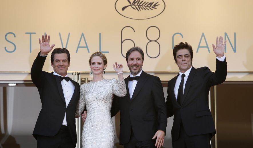 From left, actors Josh Brolin, Emily Blunt, director Denis Villeneuve and actor Benicio del Toro pose for photographers as they arrive for the screening of the film Sicario at the 68th international film festival, Cannes, southern France, Tuesday, May 19, 2015. (AP Photo/Lionel Cironneau)