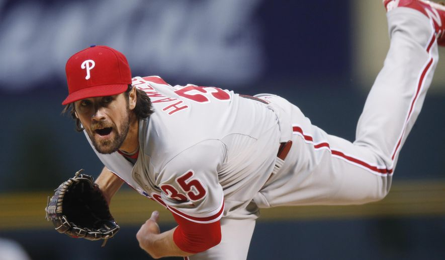 Philadelphia Phillies starting pitcher Cole Hamels works against the Colorado Rockies in the first inning of a baseball game Monday, May 18, 2015, in Denver. (AP Photo/David Zalubowski)