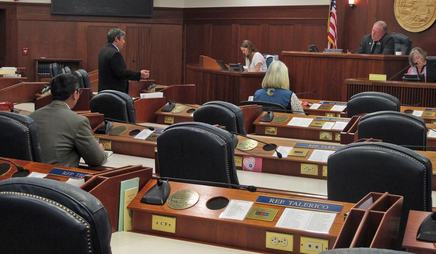 Rep. Sam Kito III, standing, speaks on the floor of the Alaska House during a technical session Tuesday, May 19, 2015, in Juneau, Alaska. Four of the House's 40 members attended the session as attendance was not required. (AP Photo/Becky Bohrer)