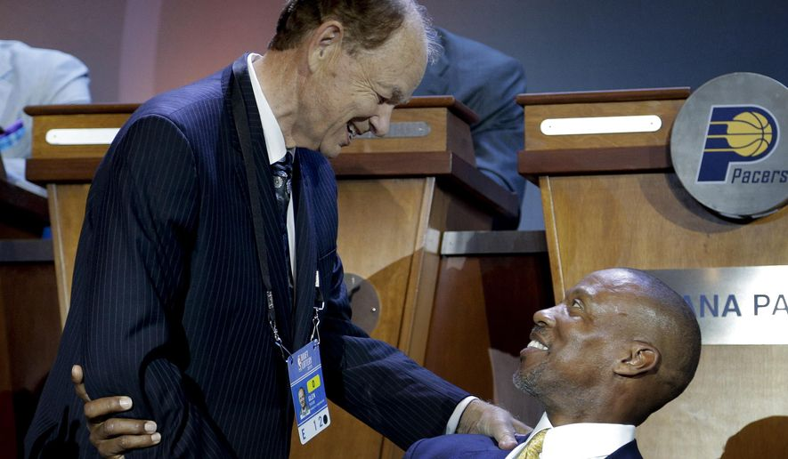 Minnesota Timberwolves owner, Glen Taylor, left, talks with Los Angeles Lakers coach Byron Scott before the NBA basketball draft lottery, Tuesday, May 19, 2015, in New York. (AP Photo/Julie Jacobson)