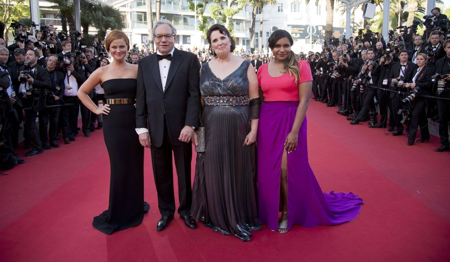 From left, actress Amy Poehler, comedian Lewis Black, actors Phyllis Smith and Mindy Kaling poses for photographers upon arrival for the screening of the film Inside Out at the 68th international film festival, Cannes, southern France, Monday, May 18, 2015. (AP Photo/Thibault Camus)