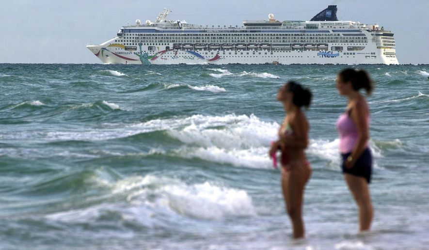 FILE - In this Sept. 1, 2004, file photo, the cruise ship Norwegian Dawn heads out into the Atlantic Ocean from the southern tip of Miami Beach, Fla. An official with Bermuda's Rescue Coordination Center says the ship Norwegian Dawn hit the reef near Bermuda's North Channel, Tuesday, May 19, 2015. The official said the ship is in a stable position. Norwegian Cruise Line said in a brief statement that the ship temporarily lost power and its propulsion was affected but that everyone aboard is safe and that the ship has full power. (AP Photo/Bill Cooke, File)