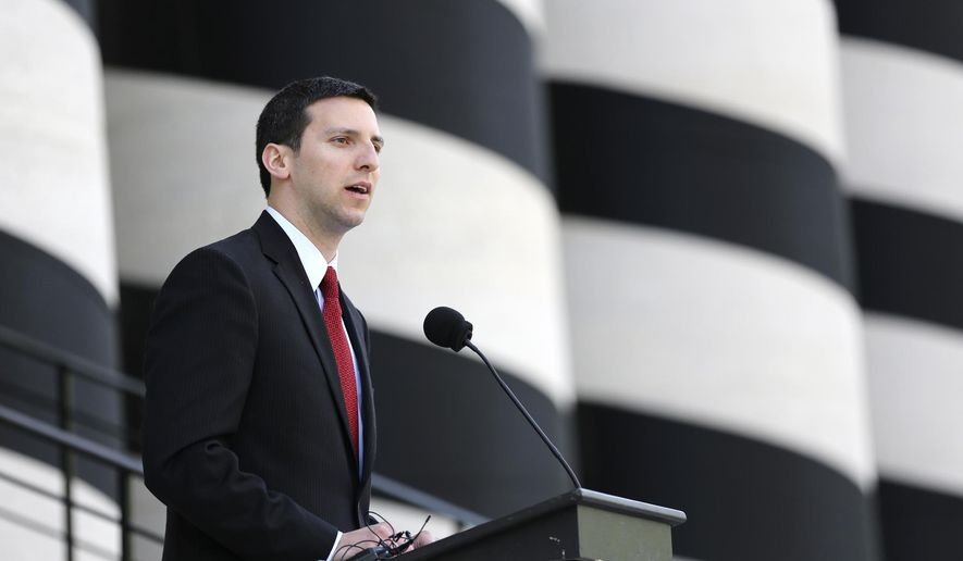 Cincinnati Councilman P.G. Sittenfeld speaks outside of the Ohio Statehouse, Thursday, May 14, 2015, in Columbus, Ohio. Sittenfield, running for U.S. Senate, says he intends to stay in the race while emphasizing the need to give Democrats a choice in the election. He faces a primary challenge from 73-year-old former Gov. Ted Strickland. Each wants to unseat Republican Sen. Rob Portman in next year's election. (Courtney Hergesheimer/The Columbus Dispatch via AP)