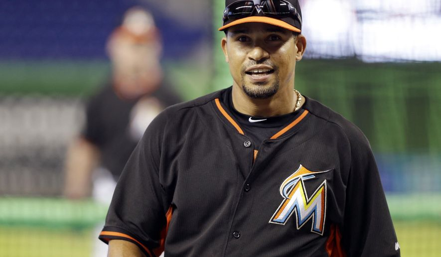 FILE - In this Wednesday, April 30, 2014 file photo, Miami Marlins second baseman Rafael Furcal (15)  smiles during batting practice before a baseball game against the against the Atlanta Braves in Miami. Former NL Rookie of the Year Rafael Furcal is retiring after 14 major league seasons, Tuesday, May 19, 2015.  (AP Photo/File)