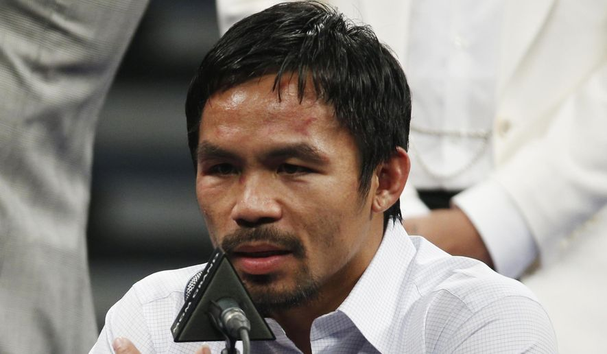 In this May 2, 2015, photo, Manny Pacquiao answers questions during a press conference following his welterweight title fight against Floyd Mayweather Jr. in Las Vegas. Boxing fans across the country or at least their lawyers are calling the hyped-up fight between Pacquiao and Floyd Mayweather a fraud. (AP Photo/John Locher,File)