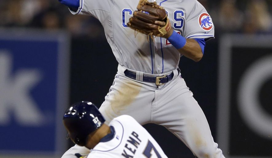 Chicago Cubs second baseman Addison Russell, above, throws to first too late for a double play as San Diego Padres' Matt Kemp, below slides in to second base during the seventh inning in a baseball game Tuesday, May 19, 2015, in San Diego. (AP Photo/Gregory Bull)